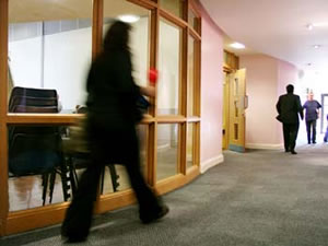 Woman walking through recently refurbished facilities